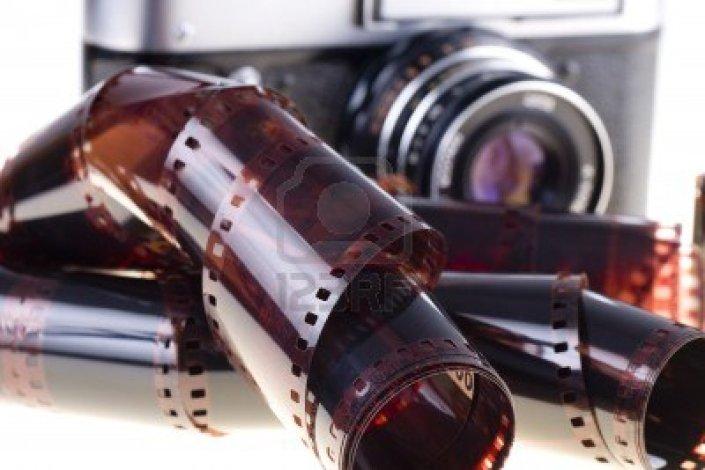 12874563-color-negative-film-and-vintage-camera