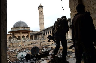BEIRUT, Lebanon — Fighting between Syrian insurgents and government forces in Aleppo left one of the Middle East's most storied mosques severely damaged on Wednesday, its soaring minaret toppled by explosives. Each side accused the other of responsibility for the destruction at the Umayyad Mosque in Aleppo's walled ancient city, a Unesco World Heritage site.
