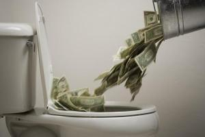 48337755-dump-money-in-toilet-gettyp.600x400